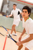 Males playing squash — Foto Stock