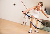Woman playing squash — Stok fotoğraf