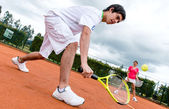 Couple playing tennis — Stock Photo