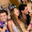 Stock Photo: Friends at bar