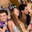 Friends at the bar — Stock Photo