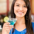 Stock Photo: Woman drinking a cocktail