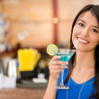 Woman having a drink — Stock Photo