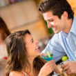 Couple having drinks - Stock Photo