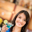 Woman drinking a martini — Stock Photo