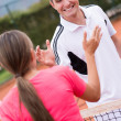 Happy tennis trainer - Stock Photo