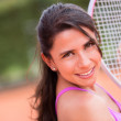 Womplaying tennis — Stock Photo #25107549