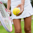 Tennis player hitting the ball — Stock Photo