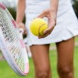 Royalty-Free Stock Photo: Tennis player hitting the ball