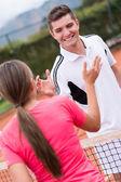 Happy tennis trainer — Stock Photo