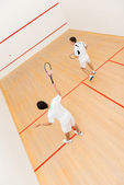 Men playing squash — Stock Photo