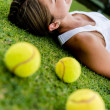 Royalty-Free Stock Photo: Tennis player relaxing outdoors