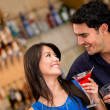 Couple on a date having drinks - Stock Photo