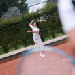 Stock Photo: Male serving at tennis