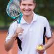 Royalty-Free Stock Photo: Happy tennis player