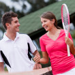 Couple at the tennis court - 图库照片