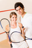 Couple of squash players — Stock Photo