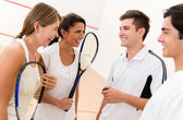 Group of squash players — Stock Photo