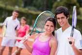 Tennis couple playing doubles — Stock Photo