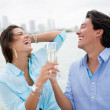 Romantic couple drinking champagne — Stock Photo