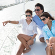 Friends sailing on a boat - Stock Photo