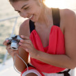Woman holding a camera — Stock Photo