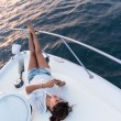 Woman relaxing on a boat — Stock Photo