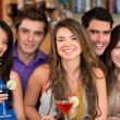 Stock Photo: Group of friends at the bar