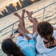 Women relaxing on a yacht — Stock Photo
