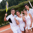 Happy group of tennis players — Stock Photo #25327867