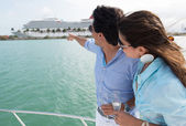Couple pointing at a cruise — Stock Photo