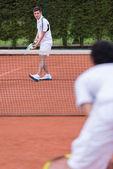 Men playing tennis — Stock Photo