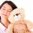 Woman daydreaming with a teddy bear — Stockfoto