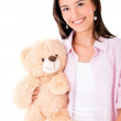 Woman holding a teddy bear — Stockfoto