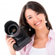 Woman holding a camera — Stockfoto