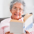 Stock Photo: Retired womreading book