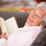 Senior woman reading a book — Stock Photo #25365235