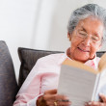 Elder woman reading a book — Stock Photo #25365397