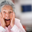 Surprised elder woman - Stock Photo