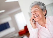 Happy senior woman on the phone — Stok fotoğraf