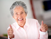 Senior woman with thumbs up — Stock Photo