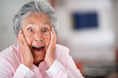 Surprised elder woman — Stock Photo