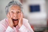 Surprised elder woman — Stock Photo