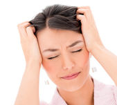 Frustrated woman with a headache — Stock Photo