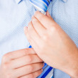 Business man fixing his tie — Stock Photo