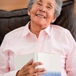Senior woman reading a book — Stock Photo #25591875