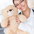 Friendly pediatrician smiling - Stockfoto