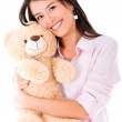 Sweet woman with a teddy bear — Stockfoto