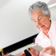 Senior woman using a smart phone — Stock Photo