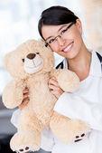 Friendly pediatrician smiling — Stock Photo